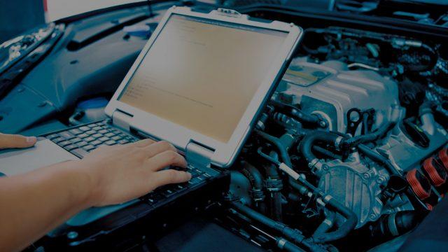 Laptop on top of automotive engine