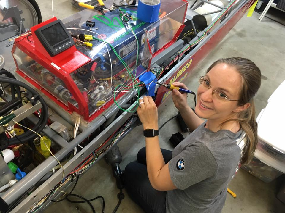 picture of eva hakansson working on the killajoule and installing a new eagle datalogger