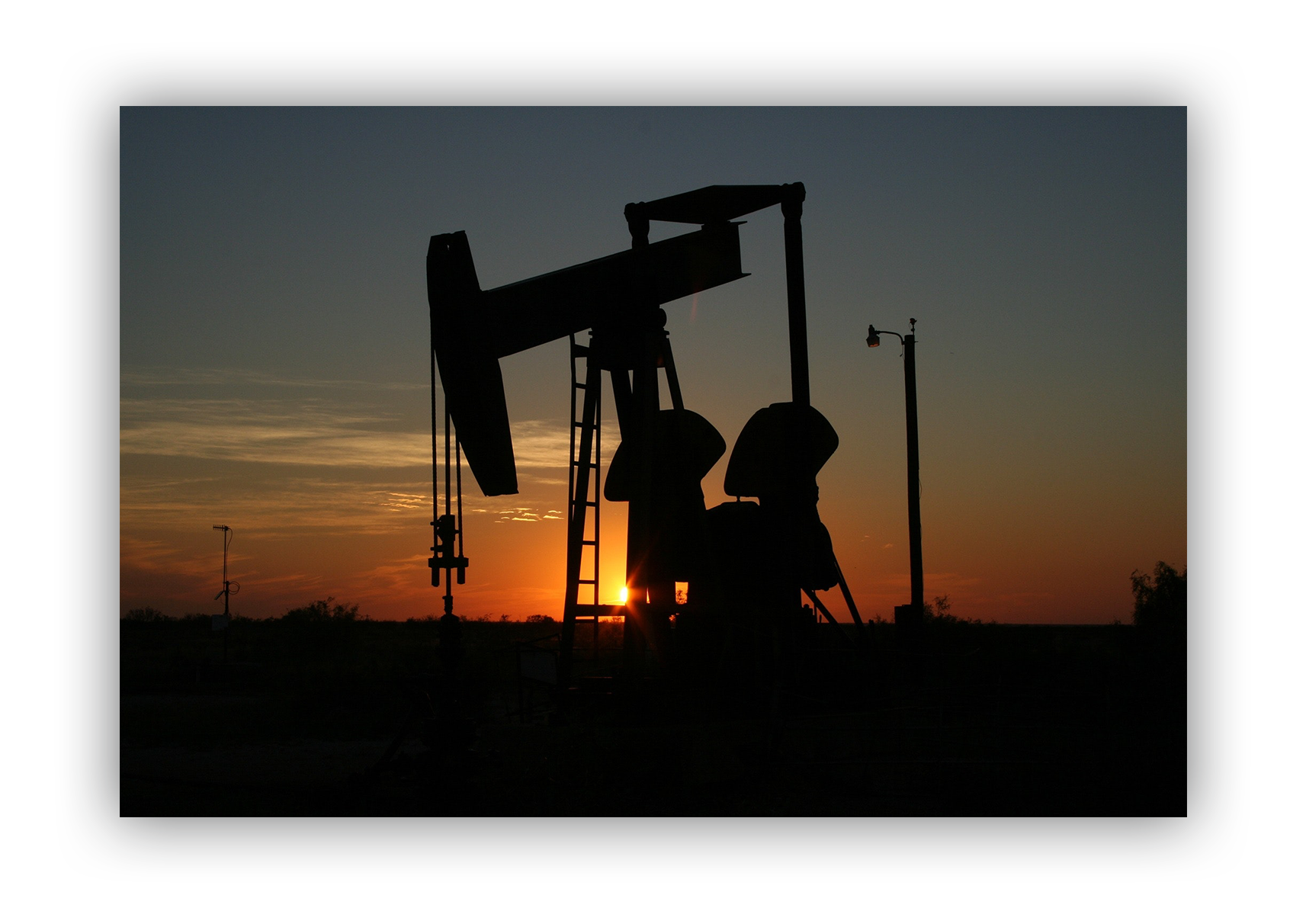oil and gas drilling at dusk